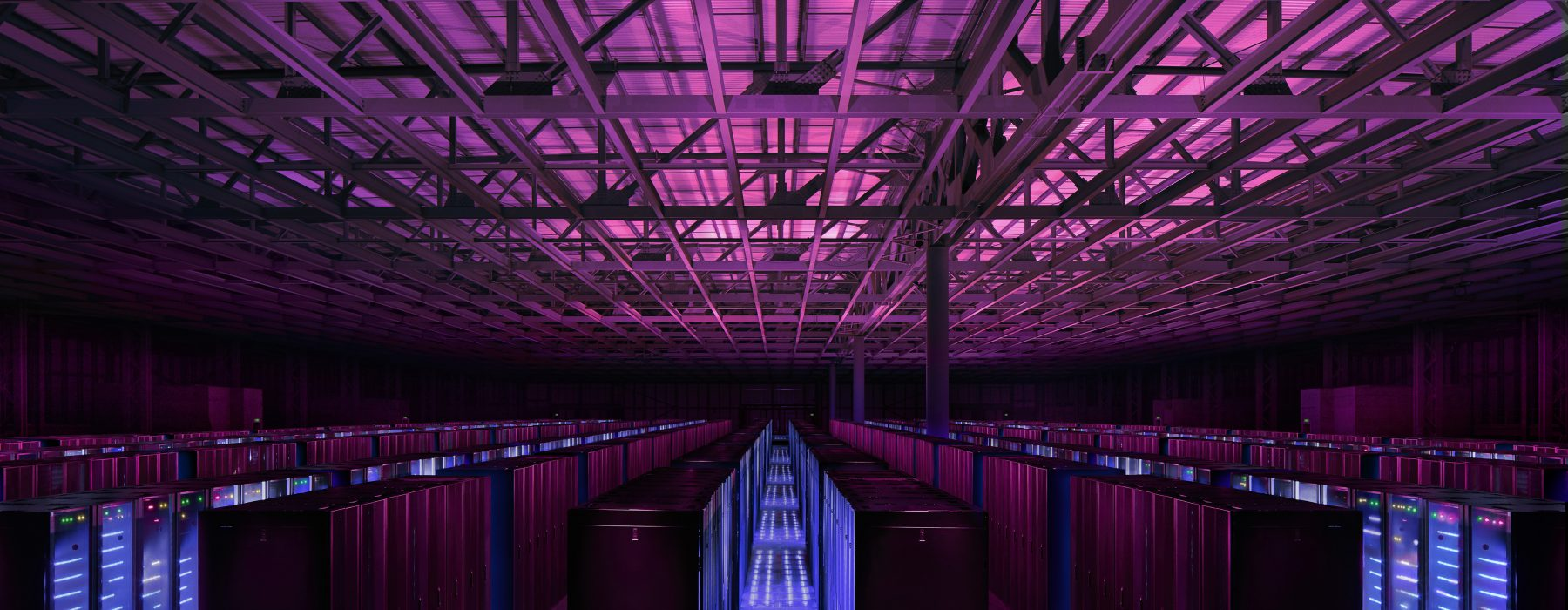 A purple-lit warehouse to represent the PSBA's public sector broadband aggregation.